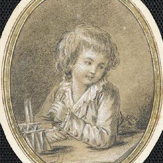 카드로 집을 만드는 아이의 초상