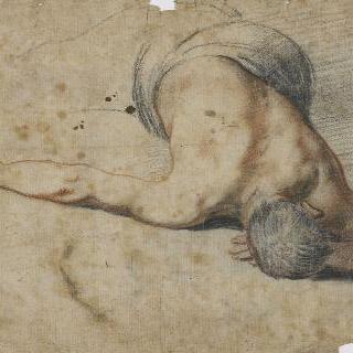 오른팔을 벌리고 바닥에 누운 남자