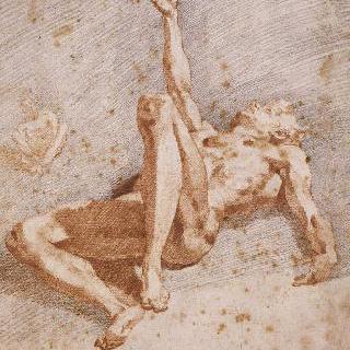 오른팔을 들고 땅에 누워있는 나체의 남자