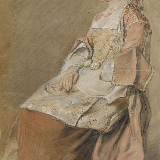 축제 의복을 입고 앉아있는 러시아 아낙네의 옆모습