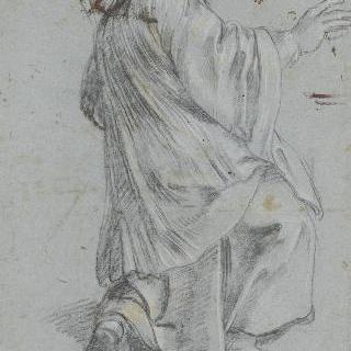 오른쪽을 향해 몸을 돌려 무릎을 꿇고 있는 가톨릭 복사