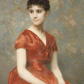 꽃밭 안쪽의 붉은 드레스를 입은 소녀
