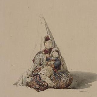 바닥에 앉아있는 레바논 여인과 무릎위의 아이