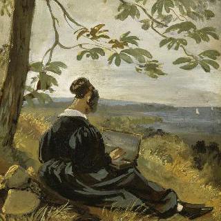 나무 아래에서 그림 그리는 젊은 여인