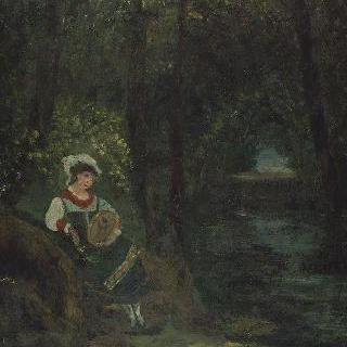 나무 아래 탬버린을 치며 앉아있는 소녀