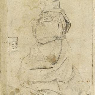 무릎을 꿇고 기도하는 수도자