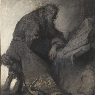 미광 속에서 책을 읽으며 앉아 있는 노인