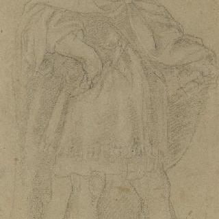 짧은 튜닉과 망토를 입은 서 있는 젊은 남자