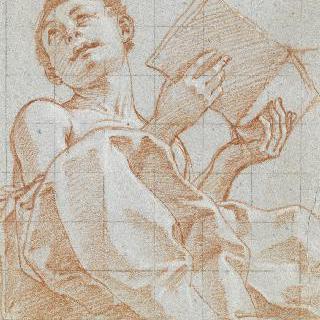 책을 들고 앉은 젊은 남자