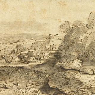 지나가는 세 명의 인물이 있는 산의 풍경