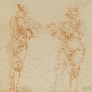 피리를 불며 서 있는 두 명의 남자