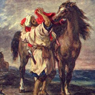 말 안장을 잡고 있는 모로코인
