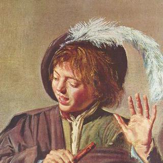 피리를 들고 노래하는 소년