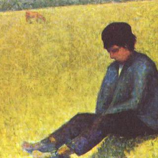 풀밭에 앉아 있는 소년