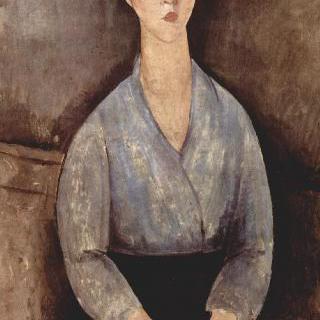 푸른 블라우스를 입고 앉아 있는 여인