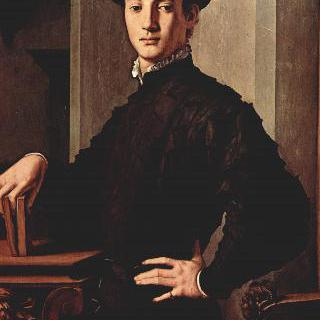 책을 잡고 있는 젊은 남자의 초상