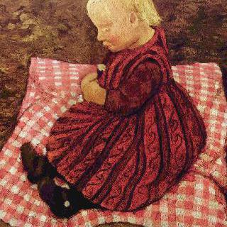 빨간 체크무늬 방석에 앉아 있는 농촌아이