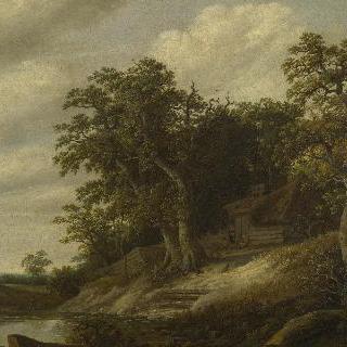 개울가 기슭에 자리한 나무들에 둘러싸인 작은 집