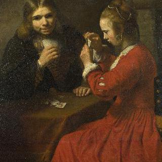 카드놀이를 하는 젊은 남자와 소녀