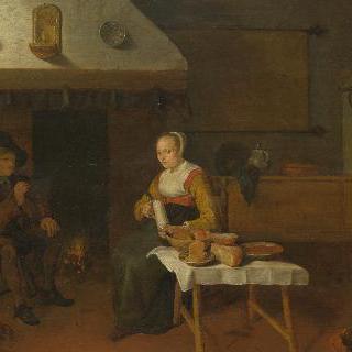 남자와 여자가 불가에 앉아 있는 실내