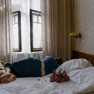 Untitled (Flowers on Bed)