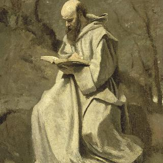 흰옷을 입고 앉아 책 읽는 수도사