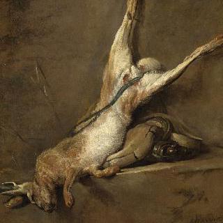 사냥 가방과 화약통 옆의 죽은 토끼